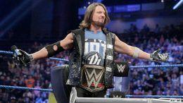 theft aj styles victim wwe wrestling champion money cash stolen