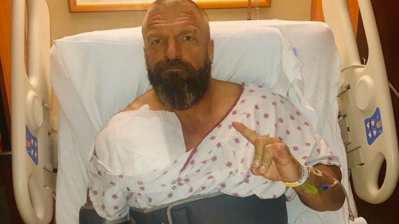 triple h surgery torn pec crown jewel wwe