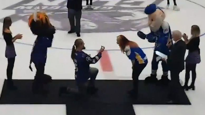 wolfgang engaged proposal video hockey game